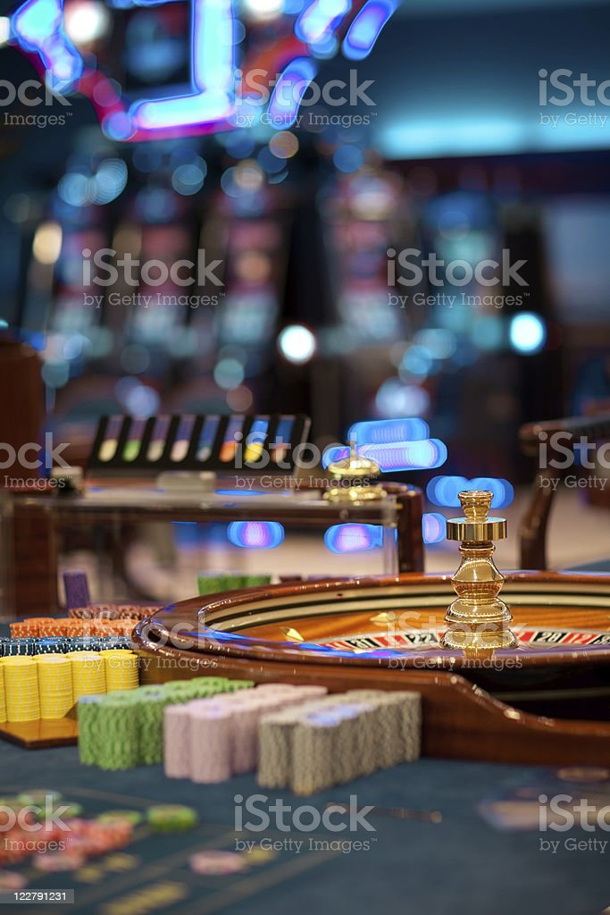roulette wheel table with chips piles stock photo