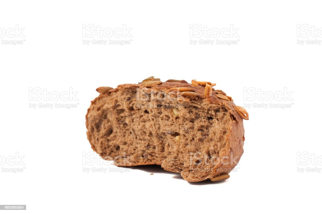 round a bun with pumpkin seeds wherein is isolated on a white background stock photo