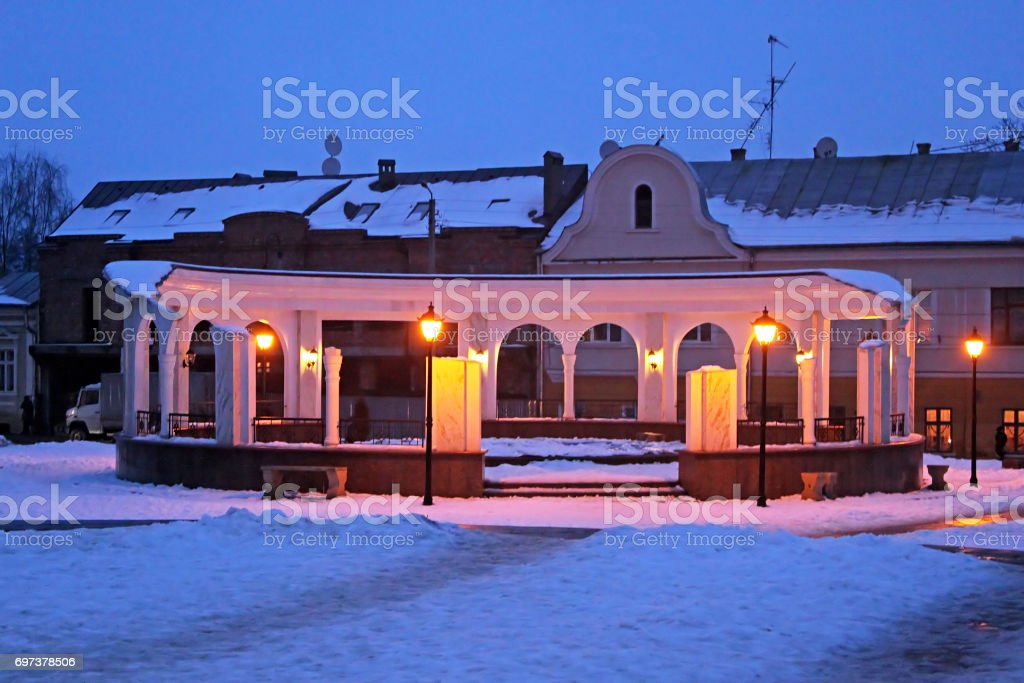 Round arcade with a fountain on Turkish Square at night in the winter in Chernivtsi, Ukraine stock photo
