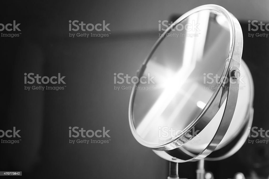 Round bathroom mirror with illumination, monochrome stock photo