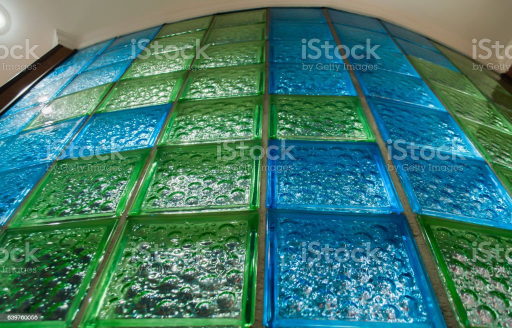 Round bathroom wall from  blue and green glass tile stock photo