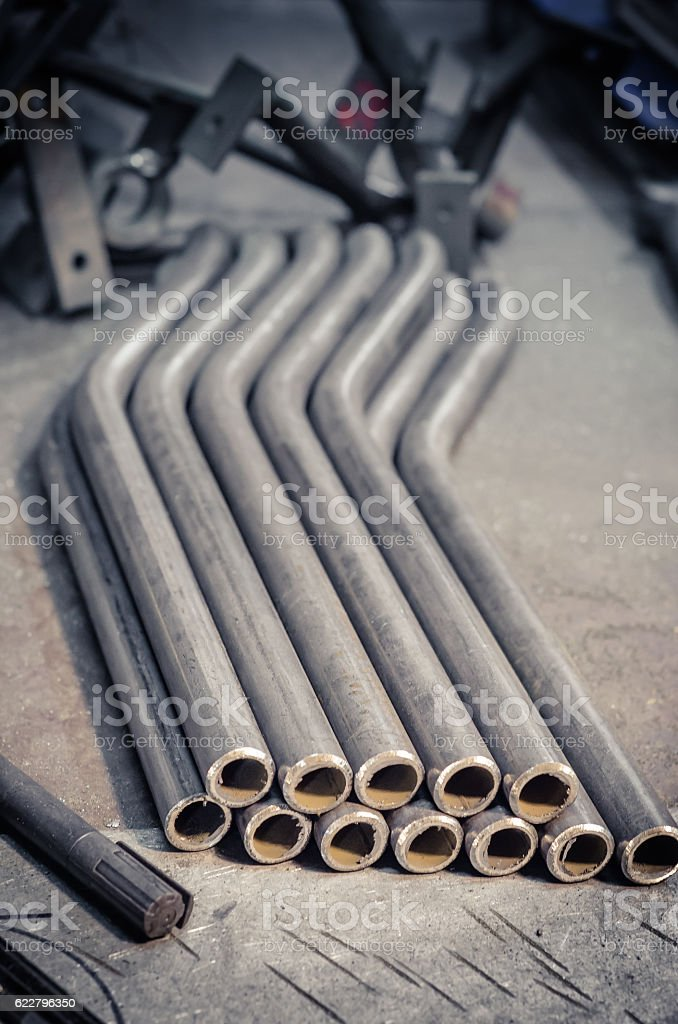 Round bent steel pipe on aluminium plate stock photo