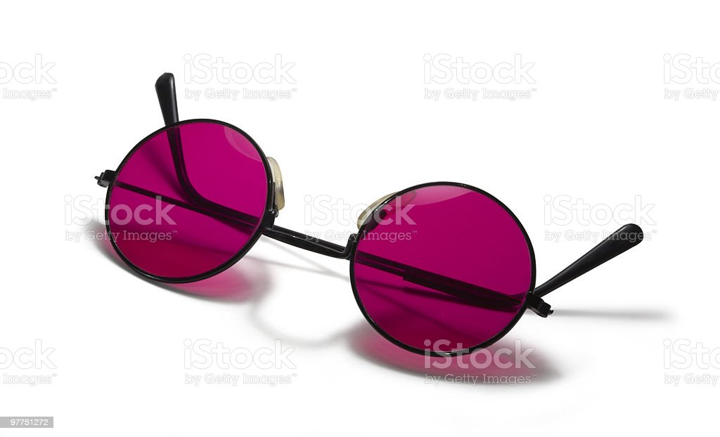 Round black glasses with pink lenses upside down on white stock photo