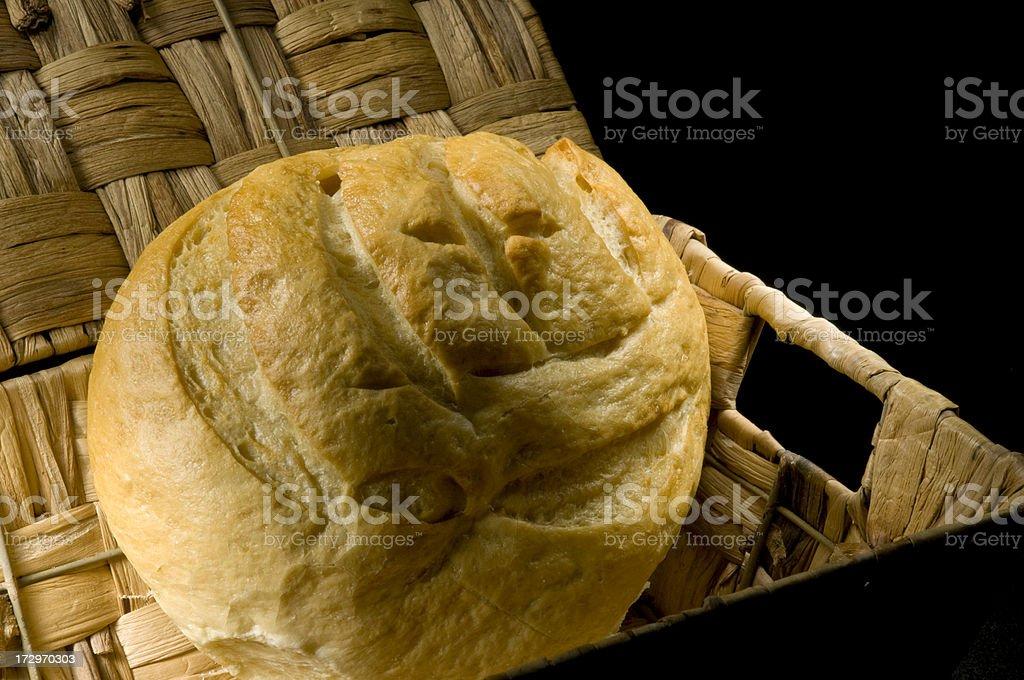 Round bread in basket stock photo