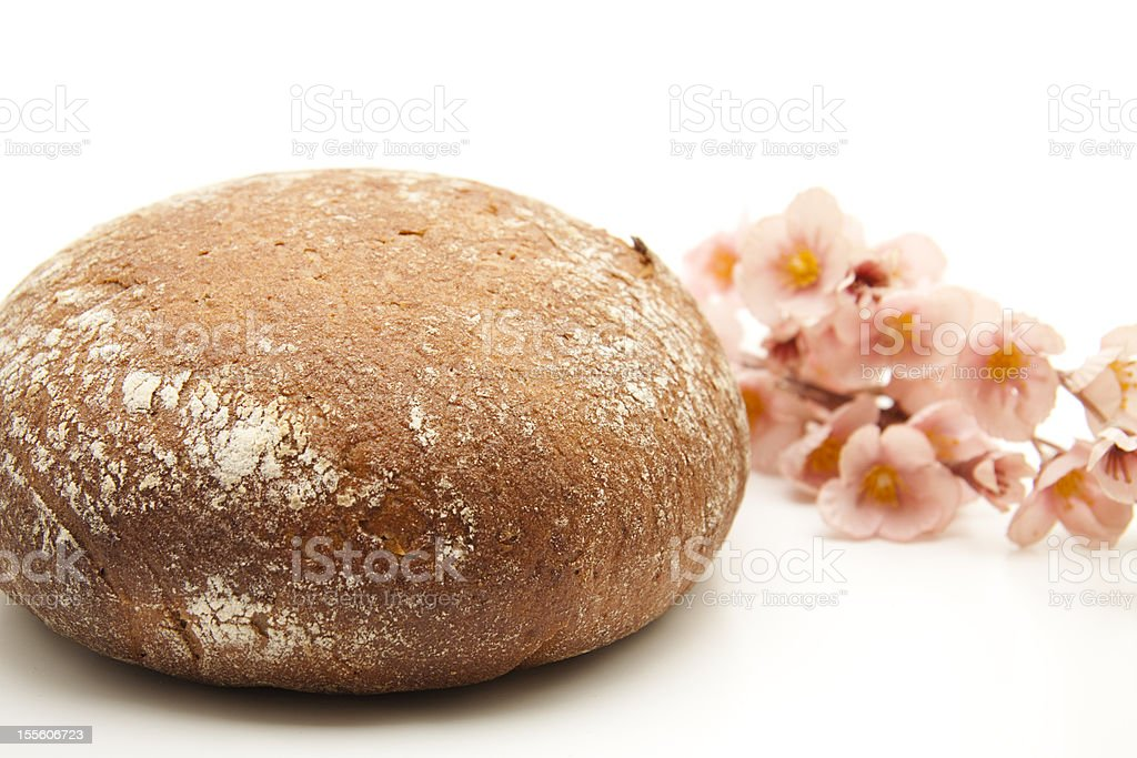 Round bread with flowering branch stock photo