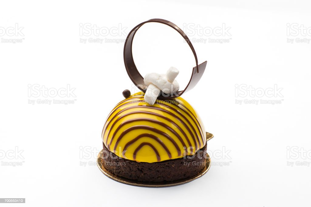 Round cake in a glaze in the form of a bee with a chocolate ring stock photo