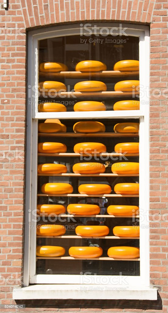 Round cheese blocks on display in a window- Netherlands stock photo