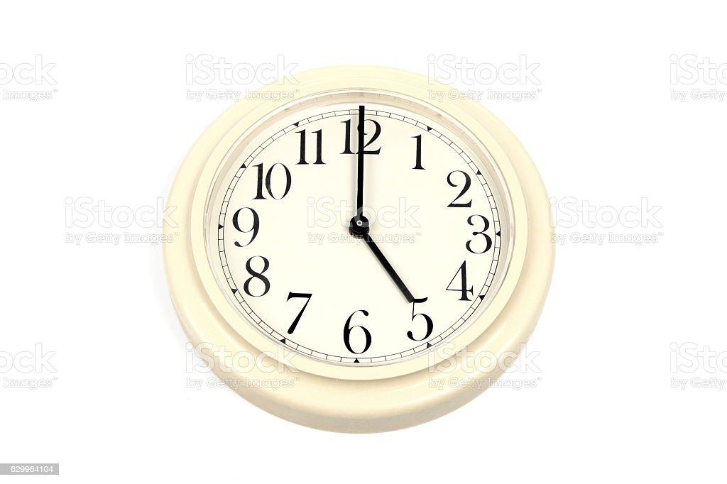 Round clockface at 5 o'clock on a white background stock photo
