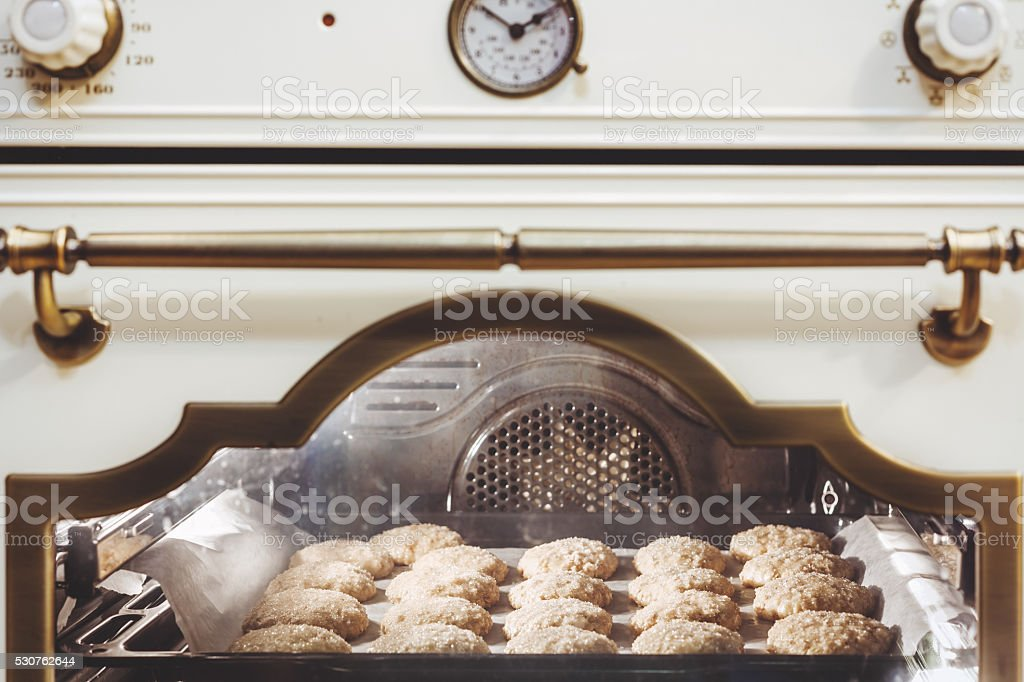 Round cookies baked in oven stock photo