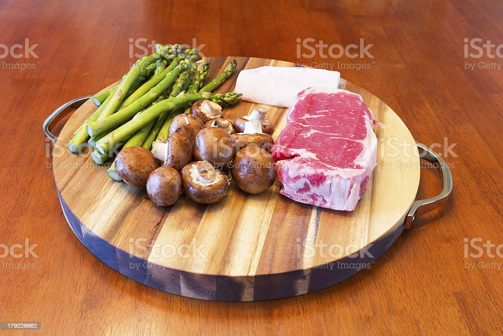 Round Cutting Board with Food royalty-free stock photo