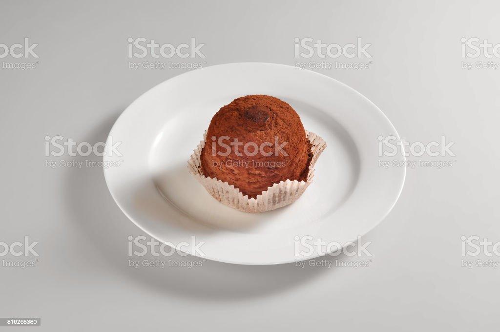 Round dish with sweet chocolate truffles stock photo