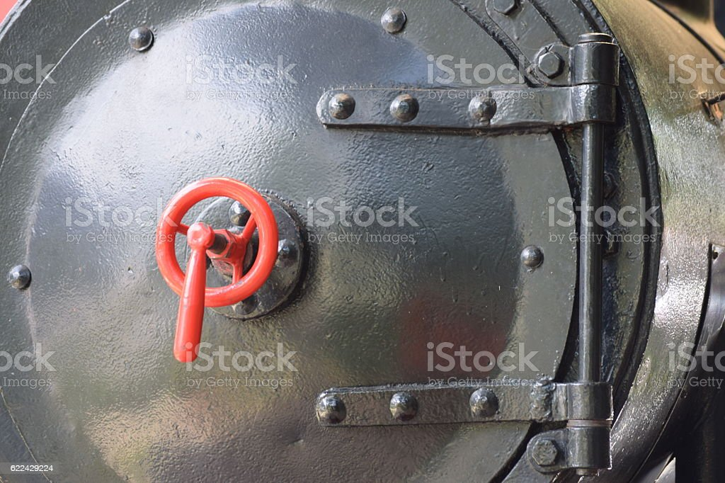 Round door of the boiler on the old steam locomotive stock photo