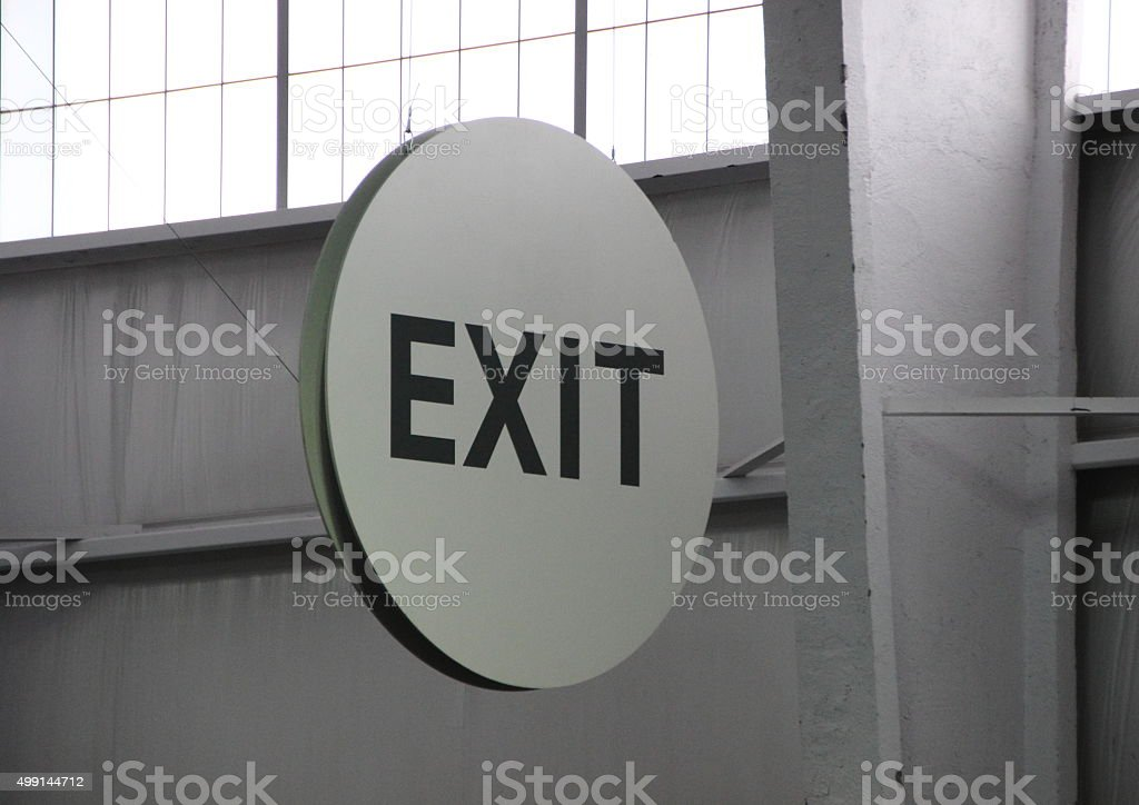 Round Exit Sign in Industrial Settings with Back light stock photo