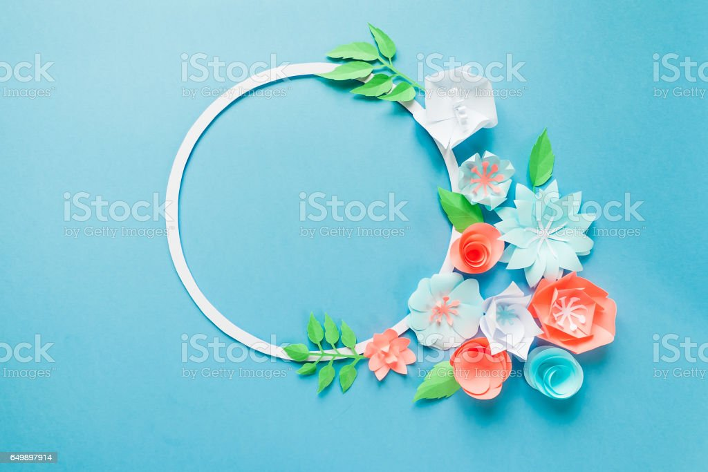 Round frame with color paper flowers on the blue background flat lay round frame with color paper flowers on the blue background flat lay nature concept mightylinksfo