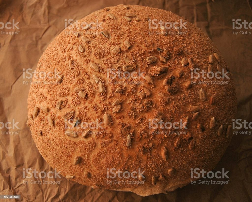 round fresh bread on a brown paper background stock photo