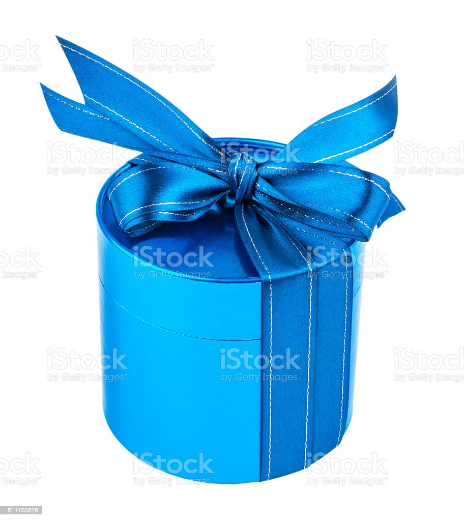 Round gift box, tied with  blue ribbon  bow on top. stock photo