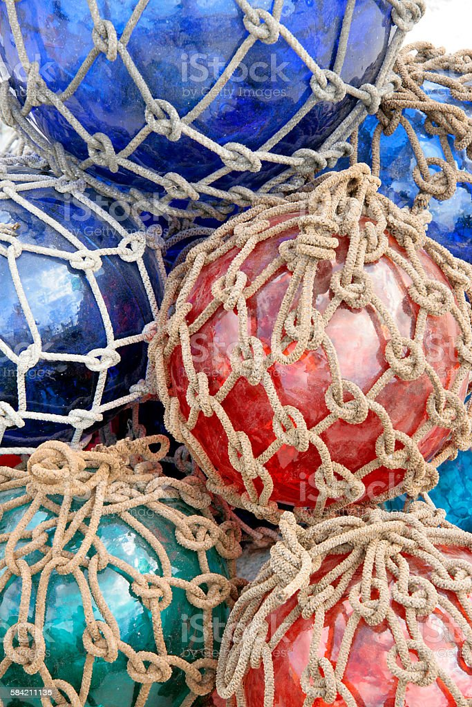 Round glass Japanese fishing floats with nets. stock photo