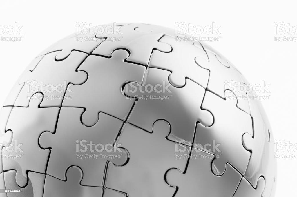 Round globe jigsaw puzzle on white background royalty-free stock photo