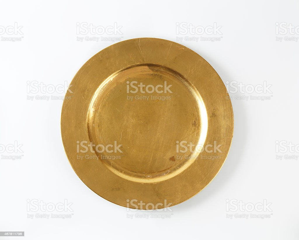 Round gold charger plate stock photo