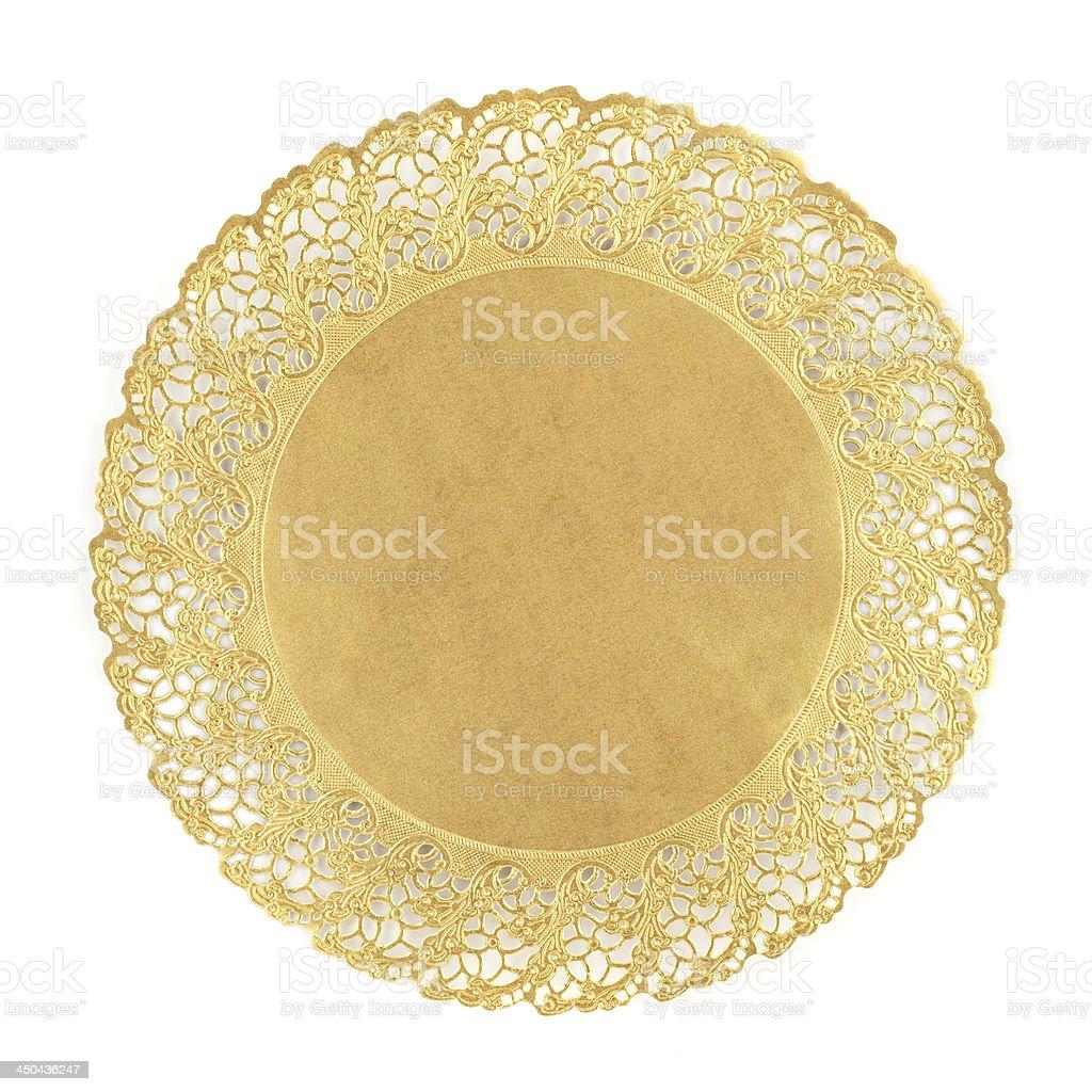 Round golden doily on white background stock photo