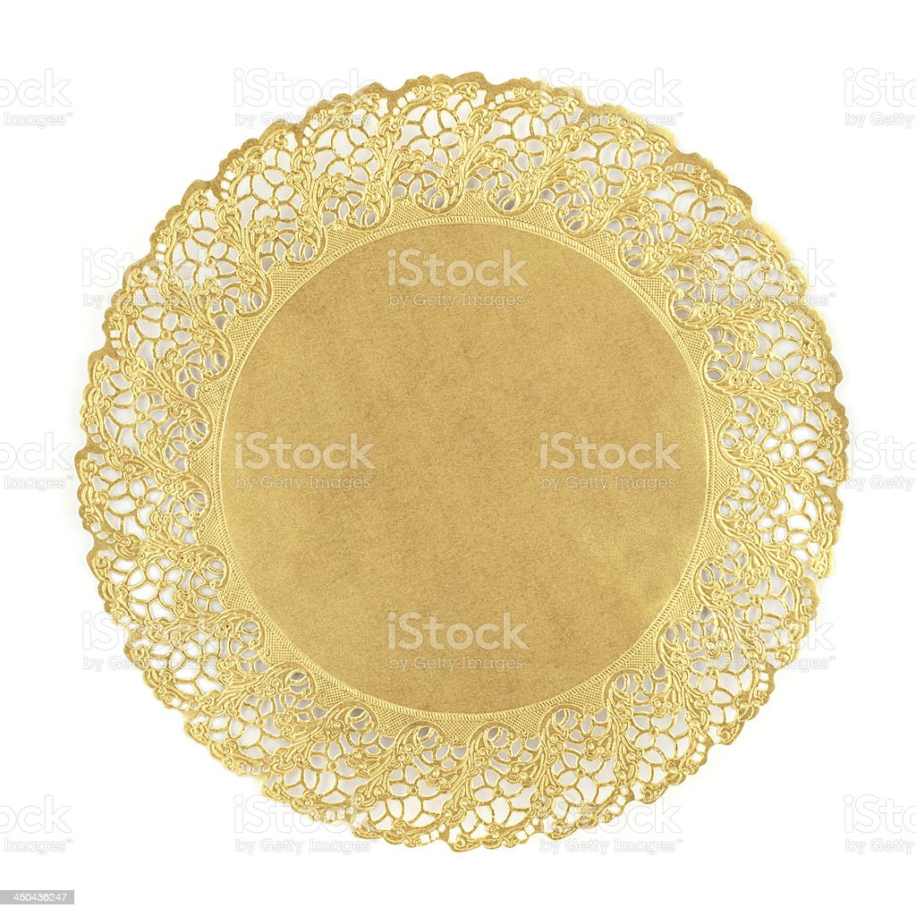Round golden doily on white background stock photo