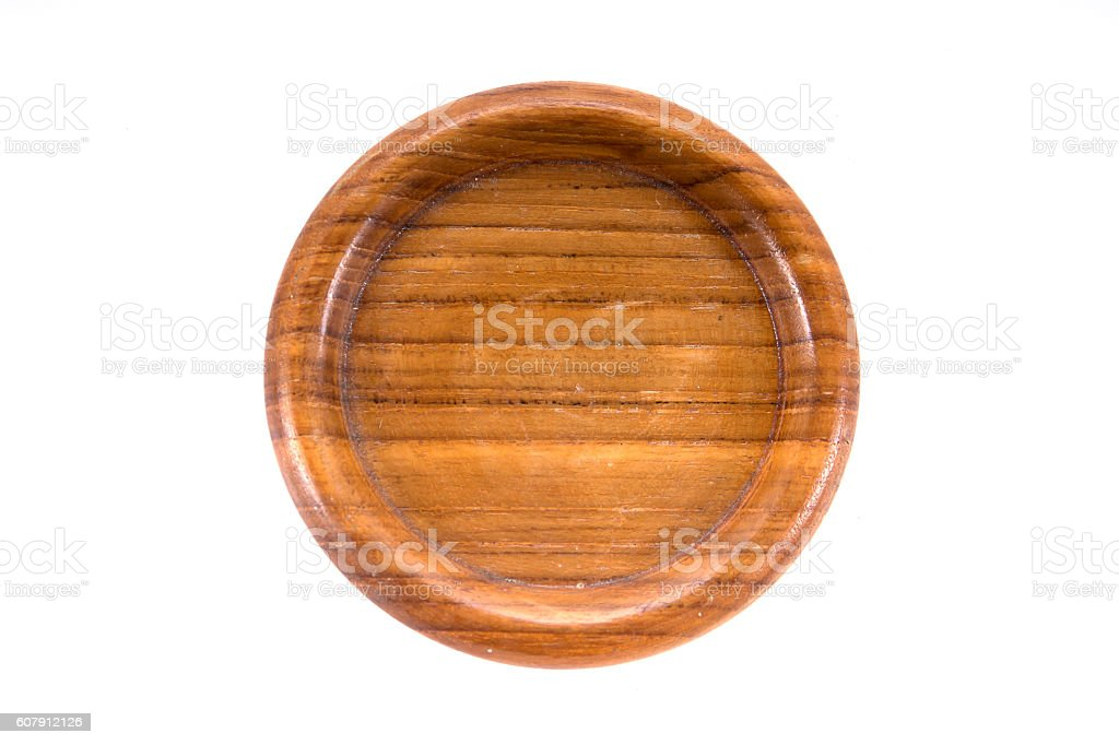 Round hand craft wooden saucer, wooden bottom plate isolated stock photo