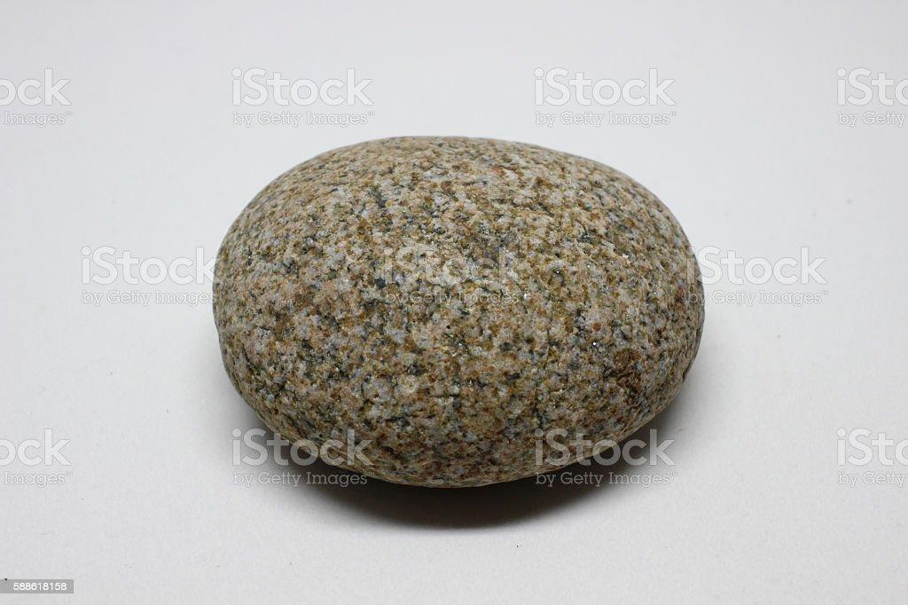 Round Orange Speckled Rock - Closeup stock photo