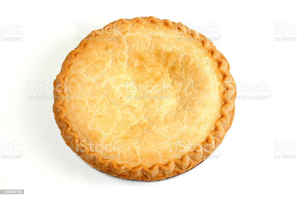 Round Pie lying on a white background royalty-free stock photo