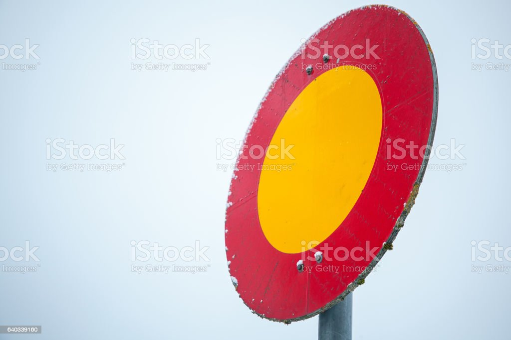 Round red and yellow stop sign stock photo