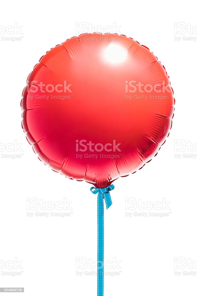 Round red helium balloon on blue cord stock photo