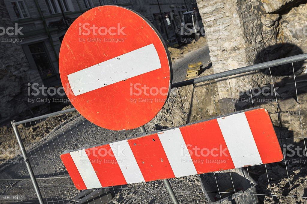 Round red sign No Entry on urban road barrier stock photo