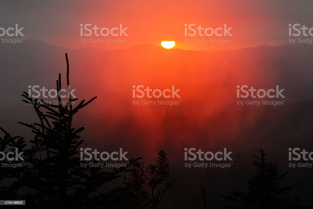 Round, red, sunset over Clingman's Dome. stock photo