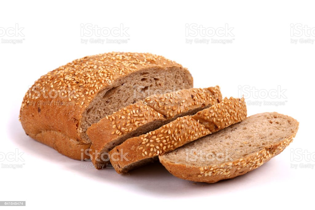 Round rye bread covered with sesame seeds stock photo