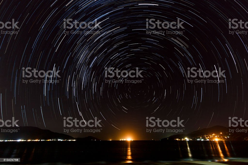 Round Star Trail Over Beach at Night stock photo