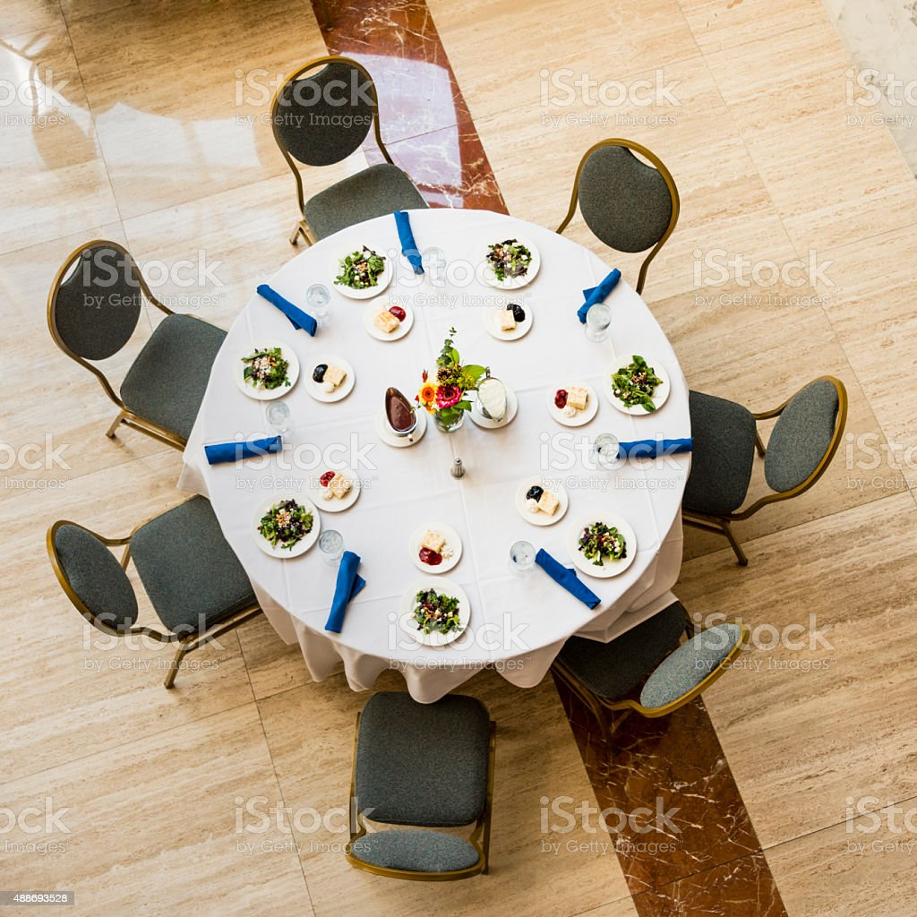 Round table with a dinner setting from above. stock photo