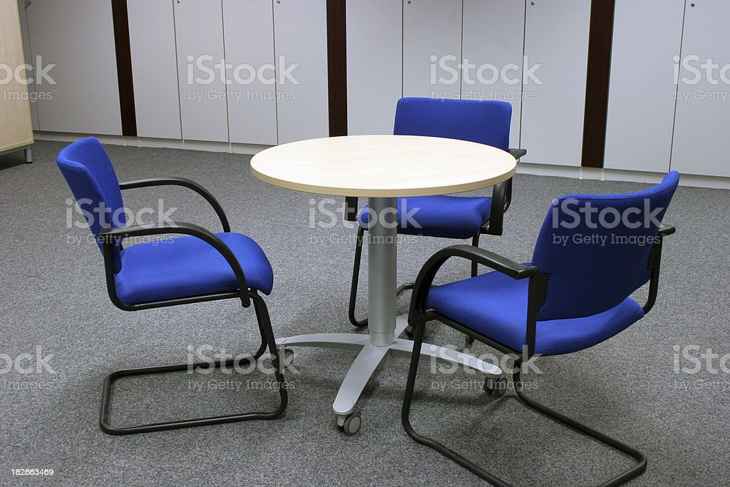 Round table with three chairs royalty-free stock photo