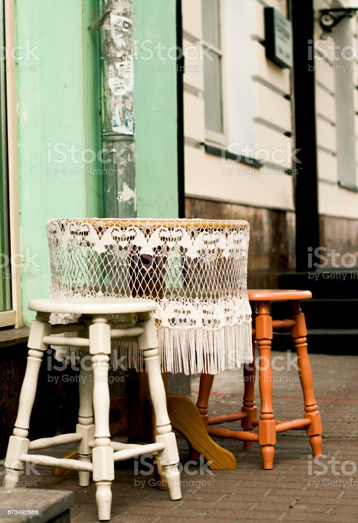 Round table with white lace tablecloth stock photo