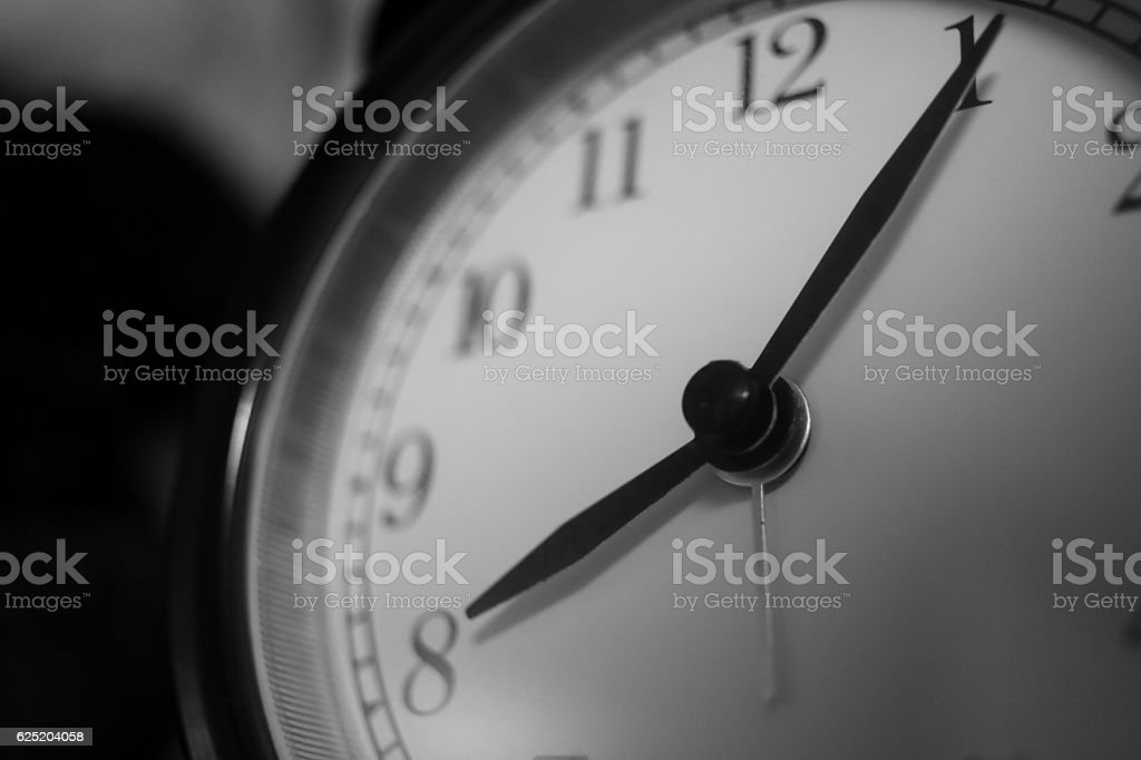 round table-clock pointing to 8:05 PM stock photo