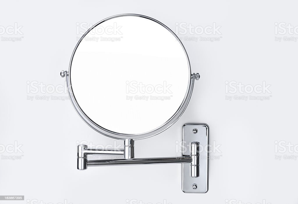 Round wall-mounted mirror stock photo