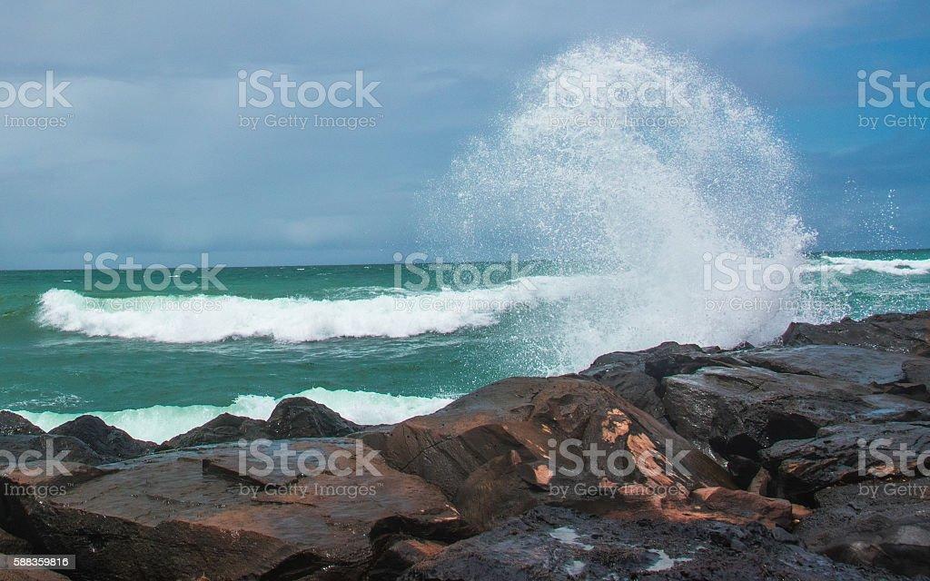 Round Wave Crashing on Maui Rock Wall stock photo