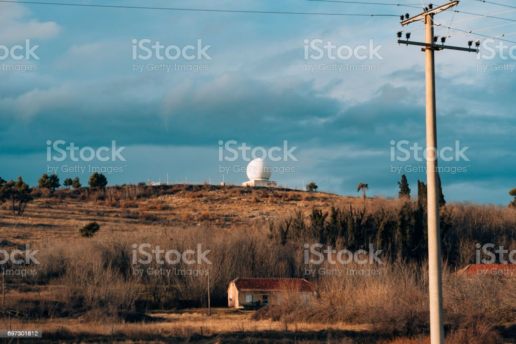 Round white observatory on a hill. Observatory in the mountains stock photo