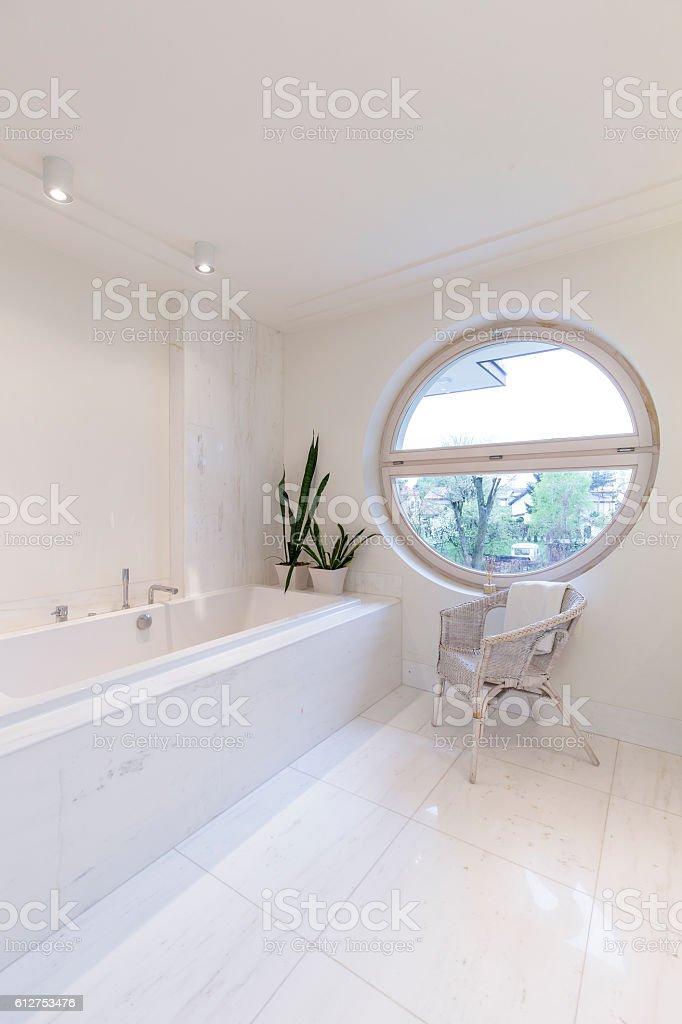 Round window in bathroom stock photo