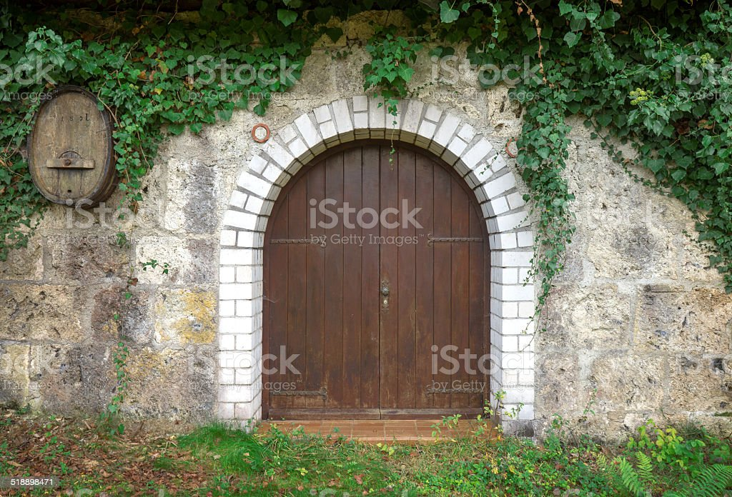 Round wooden gate of a stock of wine royalty-free stock photo