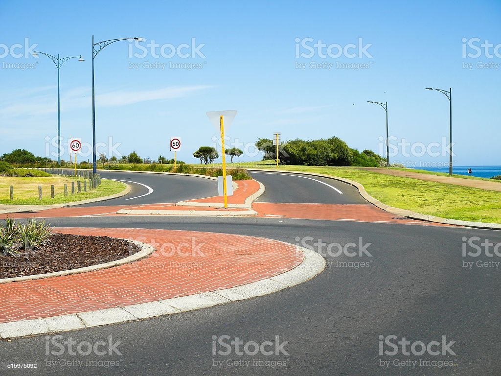Roundabout and speed limit signs stock photo