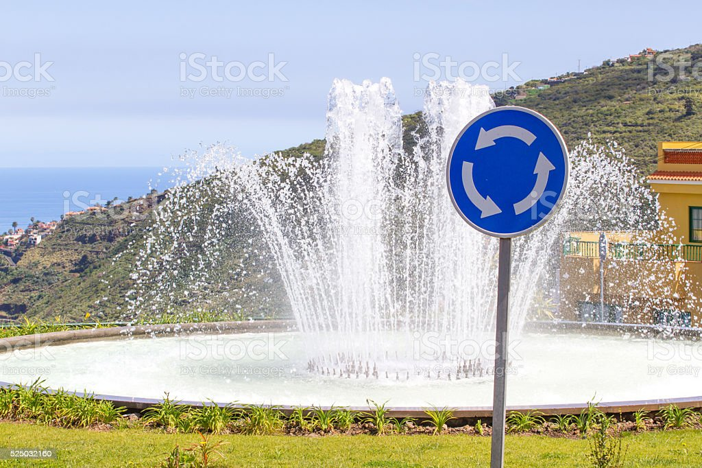Roundabout traffic sign. Curved arch arrow elements stock photo