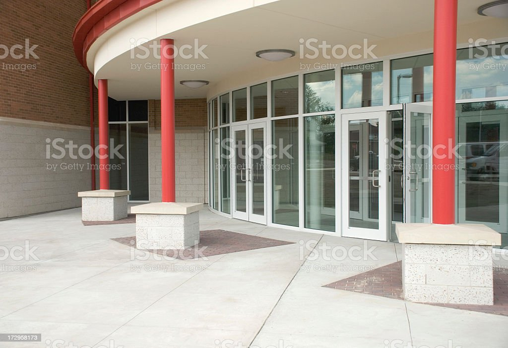 Rounded building entrance with ceiling to floor Windows royalty-free stock photo