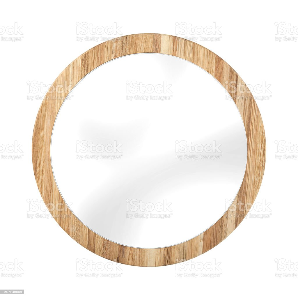 Rounded mirror in oak wooden frame - isolated on white stock photo