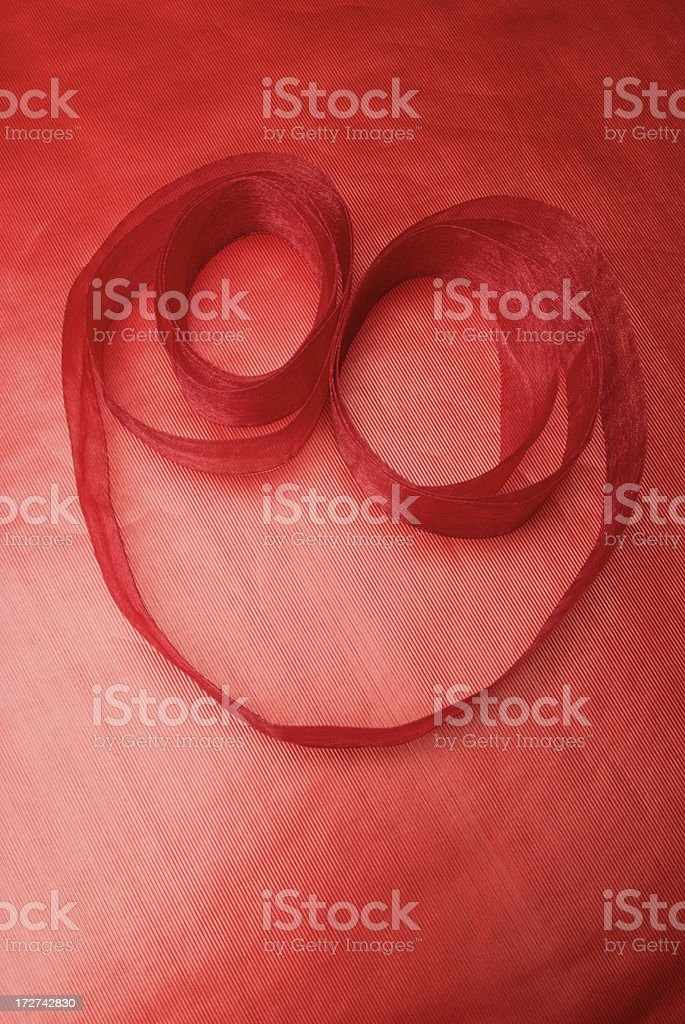 Rounded Ribbon Heart on Red Foil Paper royalty-free stock photo