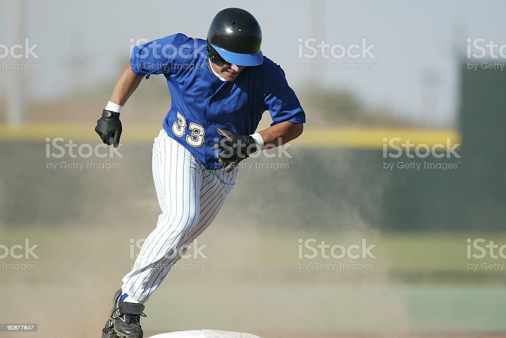 Rounding third base stock photo