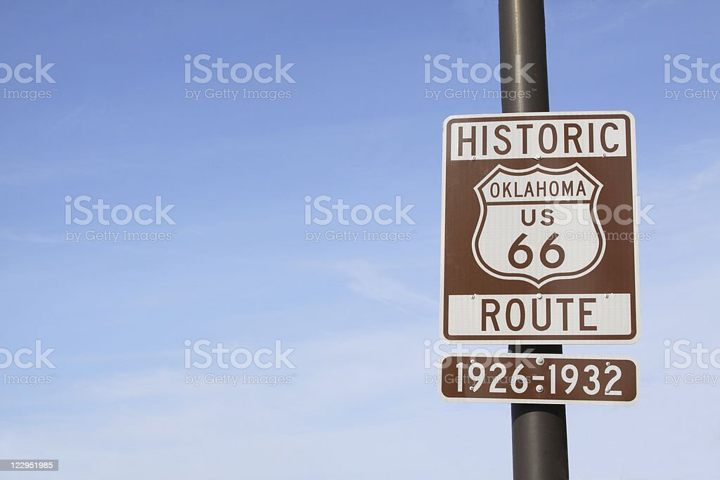 Route 66 Highway Sign in Oklahoma with Blue Sky stock photo